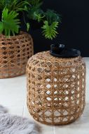 Lifestyle image of the Small Natural Woven Cane Side Table/Footstool