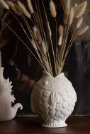 Lifestyle image of the Raw Ceramic Off-White Fish Vase