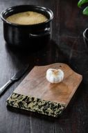 Lifestyle image of the Small Ink Dipped Mango Wood Chopping Board