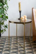 Lifestyle image of the Round Glacier-Style Glass Side Table