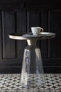 Lifestyle image of the Round Metal Tray Top Side Table With Glass Base