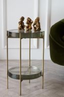 Lifestyle image of the Round Recycled Chunky Glass Side Table With Shelf