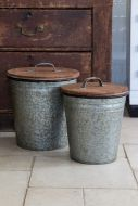 Front on angle of the Set Of 2 Zinc Bins With Wooden Lids