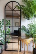 Lifestyle image of the Tall Arched Crittall-Style Mirror Suitable For Outdoors