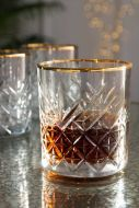 Lifestyle image of the Vintage Cut Glass Tumbler With Gold Rim