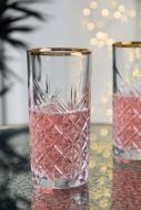 Lifestyle image of the Vintage Cut Glass Hi Ball With Gold Rim