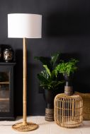 Lifestyle image of the Wonder Wicker Floor Lamp With White Shade