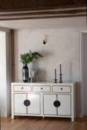 Front on lifestyle image of the Oriental Gloss White Sideboard