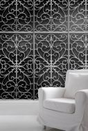 lifestyle image of Young & Battaglia Wrought Iron Metal Gate Wallpaper with white armchair
