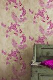 lifestyle image of Barneby Gates Paisley Wallpaper - Hot Pink on Tea Stain - SAMPLE with distressed green bench and pink cushion