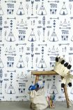 lifestyle image of Hibou Home Teepees, A Tribal Gathering Children's Wallpaper - Indigo/White HH01002 - SAMPLE with wooden side table with paper crown and bag of toys