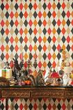 lifestyle image of Cole & Son Whimsical Collection - Punchinello Wallpaper - 6 Colours Available with wooden table with many ornaments on