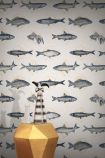 lifestyle image of Feathr Fishes In Geometrics Wallpaper - Sand & Orange with gold side table and vases on top