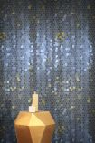 lifestyle image of Feathr Firefly Wallpaper - Blue - ROLL with gold side table and candles on top