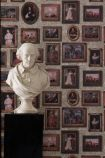 lifestyle image of andrew martin gallery wallpaper - 4 colours available with white bust of a man on black pillar