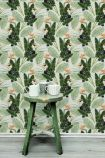 lifestyle image of Mind The Gap Birds Of Paradise Wallpaper with green wooden side table with white mugs on