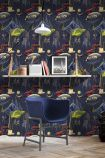 lifestyle image of mind the gap intergalactic wallpaper with blue chair under wooden shelf with picture frame and books on