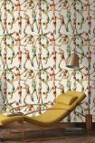 lifestyle image of mind the gap the acrobats wallpaper with yellow laying down chair and metal ceiling light