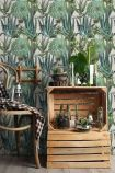 lifestyle image of Mind The Gap The Rediscovered Paradise - Succulents Wallpaper with wooden palettes and plants and wooden chair with checked blanket