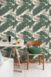 lifestyle image of mind the gap tropical bloom wallpaper with white desk and wooden chair with round green cushion on