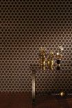 lifestyle image of Nina Campbell Gioconda Flock Wallpaper - 4 Colours Available with glass table and gold ornaments on brown flooring