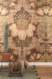 Lifestyle image of NLXL Labs MRV-02 Big Pattern Luther Wallpaper by Mr & Mrs Vintage with cactus on small side table and animal ornament on green rug