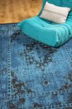 lifestyle image of the blue revive rug